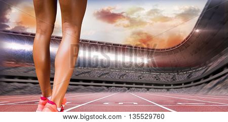Close up of sporty legs against race track