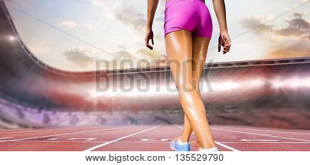 Rear view of sportswoman legs with sweat against race track