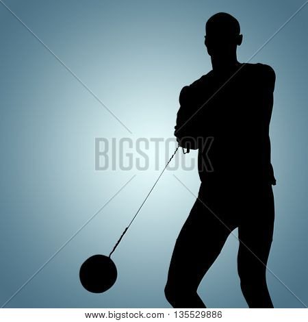 Sporty man playing at hammer throw against grey vignette