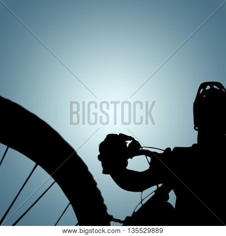 Man cycling with mountain bike against grey vignette