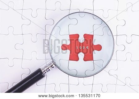 Business Concept - Magnifier Glass on white puzze with 100% Word