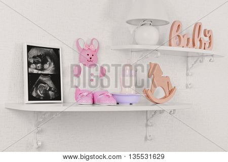 Photo frame with ultrasound scan of baby and accessories on shelves close-up
