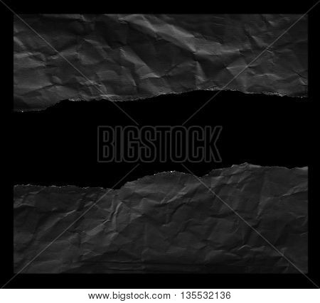 Piece of black torn paper on white background with clipping path.