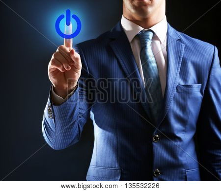 Finger press power button on virtual touch screen, modern technology concept