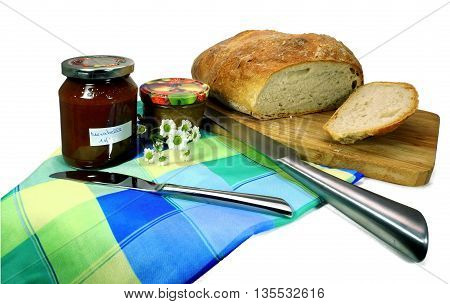 two knives bread and a jar of jam. an image that shows all
