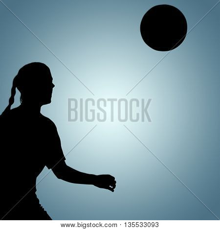Woman soccer player waiting the ball against grey vignette