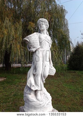 The girl with the harvest in a city park