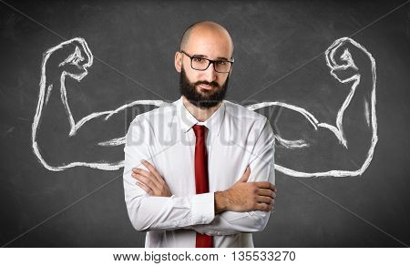 Strong and crafty Businessman, Muscles Drawn On Blackboard
