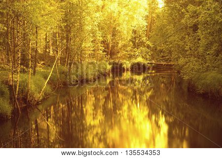 summer landscape misty morning on the river in the Ural Mountains and the railroad along