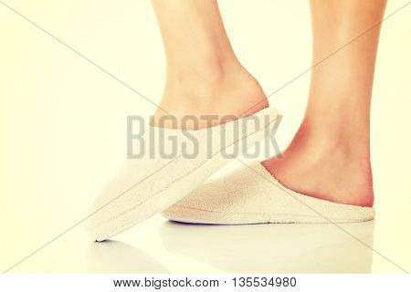 Feet with white slippers.