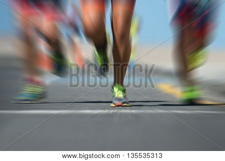 Marathon runners in the race, feet on road,abstract