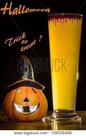 halloween pumpkin and halloween beer with halloween trick or treat written