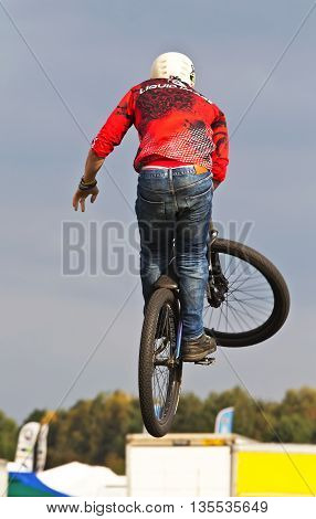 NEWBURY, UK - SEPTEMBER 21: A rider from a freestyle BMX team displays his stunting prowess to the watching public as part of the entertainment show at the Berks show on September 21, 2014 in Newbury