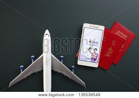 Kual Lumpur,Malaysia 19th Jun 2016,thai mobile airline mobile apps with toy aeroplane