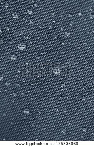Gray rainproof tent sheet with rain drops