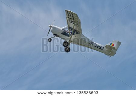 BRAILA, ROMANIA - MAY 28, 2016: Recreational flying airplane with smoke on air show demonstration flight.