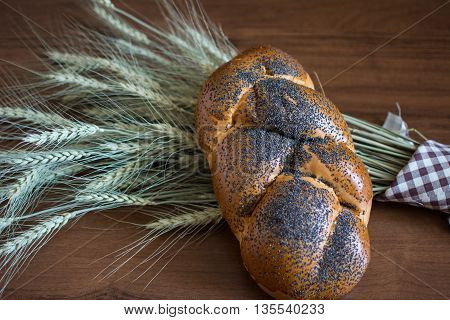 Artisan Braided roll with poppy seeds on barley ears