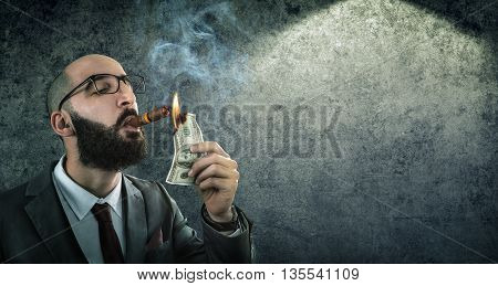 money burning - businessman arrogant burns a dollar