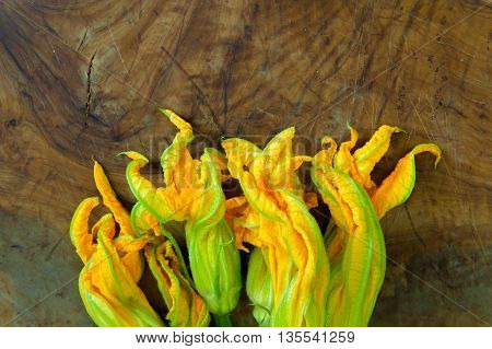 Yellow Courgette Flowers Bunch On Wood