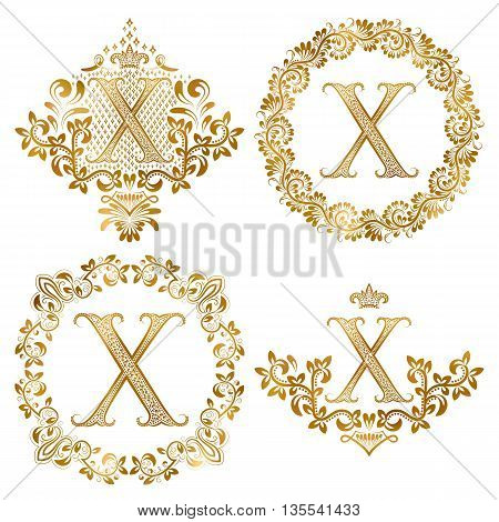 Golden X letter vintage monograms set. Heraldic coats of arms and round frames.