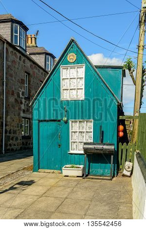 Old wooden hut in the small village of Footdee (aka Fittie). A nineteenth century fishing village close to entrance of Aberdeen harbour.