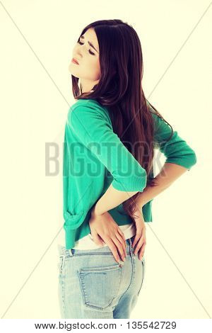 Teen woman with back pain