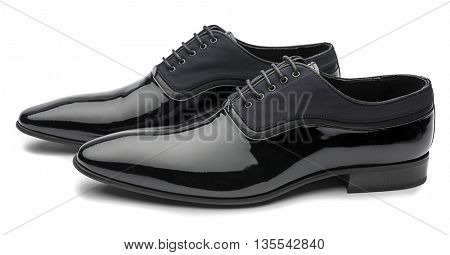 Side view of   black patent leather men shoes isolated on white background.