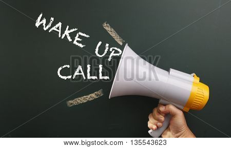 megaphone with text wake up call