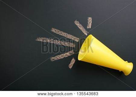 megaphone on the blackboard with copy space