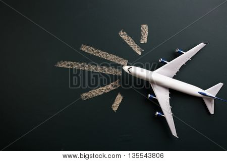 toy aeroplane on the blackboard