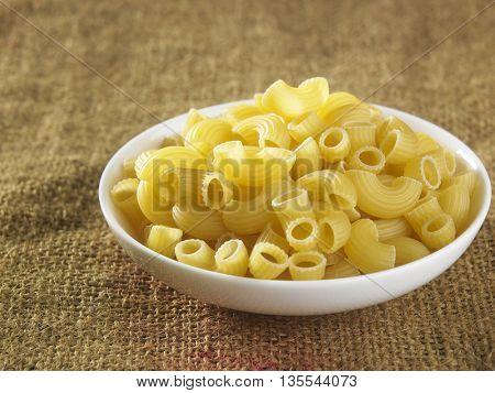 macaroni pasta on top of sack cloth