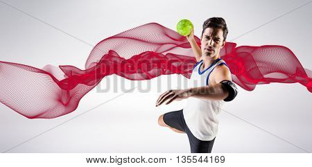 Portrait of athlete man throwing a ball against red design