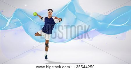 Portrait of sportsman throwing a ball against blue wave