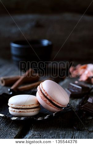 two chocolate macaroon on a dark background shot with natural light