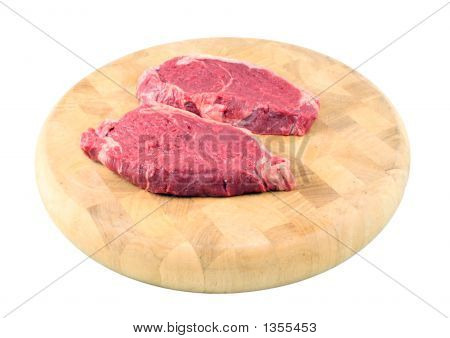Steaks On A Chopping Board