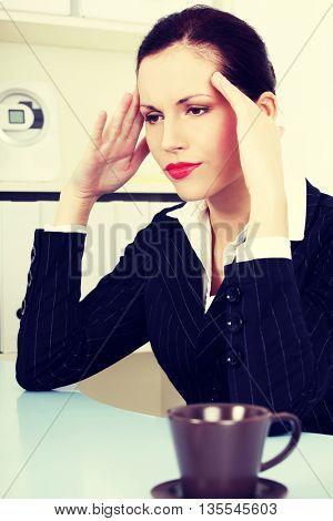 Business woman with headache.