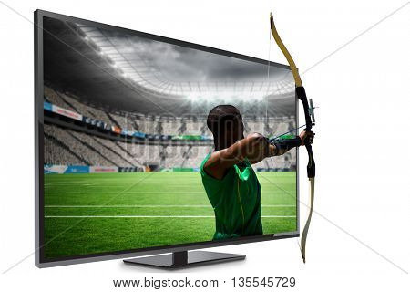 Rear view of sportsman doing archery on a white background against rugby stadium