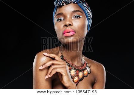 Close up portrait of an attractive african american fashion woman looking at camera