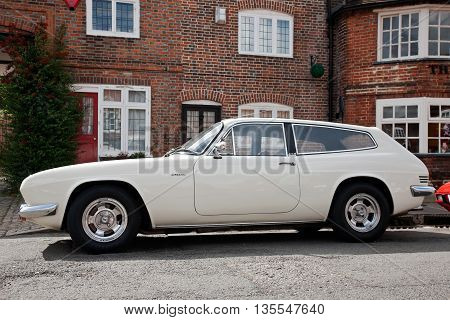 AMERSHAM, UK - SEPTEMBER 13: A vintage Jensen Interceptor sportscar is parked on the side of the highway as a static display at the Amersham Heritage Day festival on September 13, 2015 in Amersham.