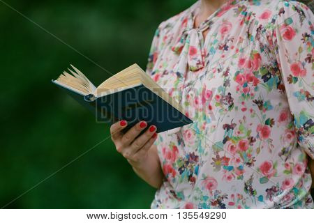 Adult Woman Reading An Open Book Old Book. Knowledge, Science.