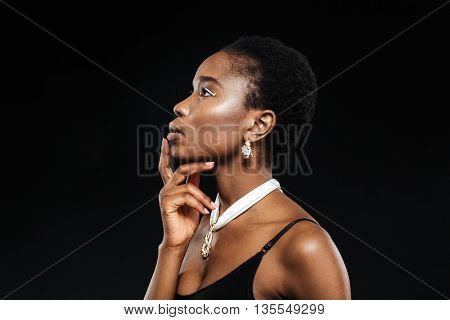 Beauty portrait of young beautiful ethnic african girl isolated on the black background