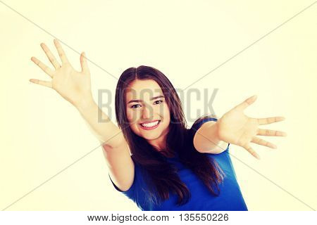Young beautiful casual woman with palms in front.