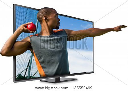 Profile view of sportsman practising shot put against athletic field on a sunny day