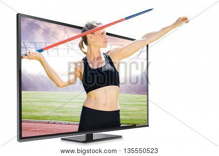Front view of sportswoman practising javelin throw against race track