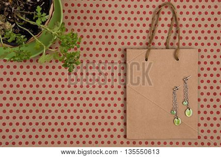 Shopping Bag Of Craft Paper, Gift Bags, Flower And Women's Fashion Jewelry On Craft  Paper Backgroun