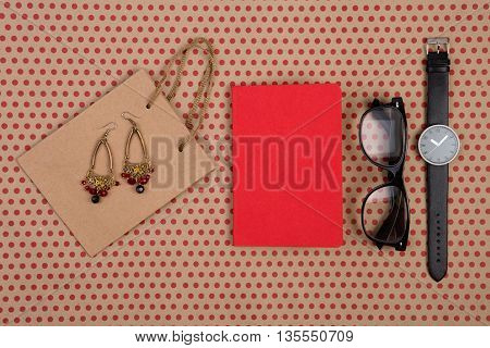 Shopping Bag Of Craft Paper, Gift Bags, Glasses, Watch, Red Notepad And Women's Jewelry On Craft  Pa