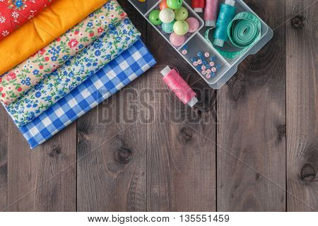 Sewing Supplies on dark rustic Wood Background