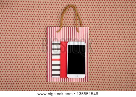 Handmade Striped Shopping Bag, Gift Bags, Notepads And White Smartphone On Craft  Paper Background I