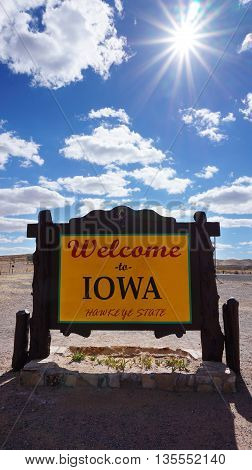 Welcome to Iowa road sign with blue sky