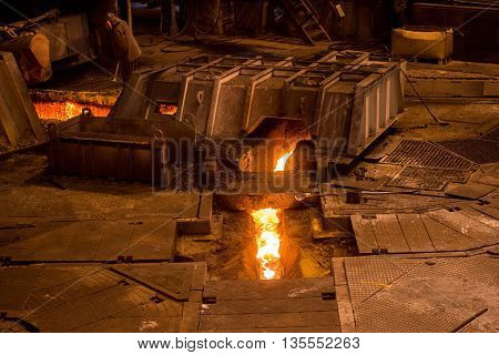 Steelworker near a blast furnace at work